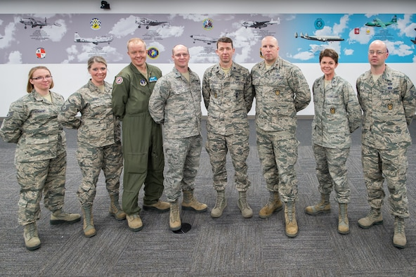 The 153rd Airlift Wing Inspector General team poses for a photo.