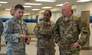 Maj. Joshua Clifford, 735th Air Mobility Squadron director of operations, briefs Gen. Carlton D. Everhart, Air Mobility Command commander, and Chief Master Sgt. Shelina Frey, Air Mobility Command command chief, on the recent renovations to the Passenger Terminal at Joint Base Pearl Harbor-Hickam, Feb. 11, 2018. Everhart visited the Airmen of the 515th Air Mobility Operations Wing Feb. 6-12 to better understand how the command can enhance enroute mobility operations support and enable global reach for the joint warfighter. The 515th AMOW, located at Joint Base Pearl Harbor-Hickam, Hawaii, oversees Air Mobility Commands enroute maintenance, command and control and aerial port support operations at 26 locations across 100 million square miles in the Pacific. (U.S. Air Force photo by Tech. Sgt. Heather Redman)