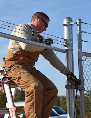 A U.S. Airman assigned to the 20th Civil Engineer Squadron constructs a fence for a new MQ-9 site at Shaw Air Force Base, S.C., Dec. 12, 2018.
