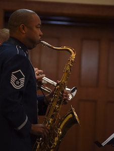 Saxophonist plays at Black History Month luncheon