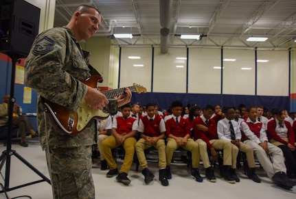 Max Impact guitarist performs for students