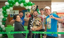 Members from Team Luke pose for a photo before a meet-and-greet event with AJ Styles, World Wrestling Entertainment professional athlete, at Luke Air Force Base, Ariz., Feb. 20, 2018. Airmen and other visitors with base access had the opportunity to take photos, receive autographs and interact with Styles during the event. (U.S. Air Force photo/Airman 1st Class Caleb Worpel)