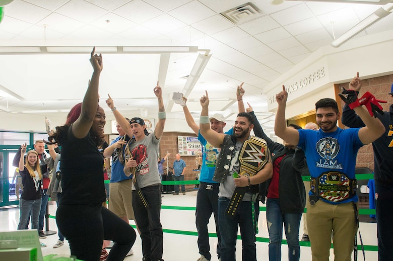 Members from Team Luke cheer for AJ Styles, World Wrestling Entertainment professional athlete, before a meet-and-greet event at Luke Air Force Base, Ariz., Feb. 20, 2018. Airmen brought various items and memorabilia for Styles to autograph during the event. (U.S. Air Force photo/Airman 1st Class Caleb Worpel)