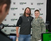 Staff Sgt. Cassandra Mallory, 56th Fighter Wing drug demand reduction team member, poses for a photo with AJ Styles, World Wrestling Entertainment professional athlete, at Luke Air Force Base, Ariz., Feb. 20, 2018. Airmen and other visitors with base access had the opportunity to take photos, receive autographs and interact with Styles during the event. (U.S. Air Force photo/Airman 1st Class Caleb Worpel)