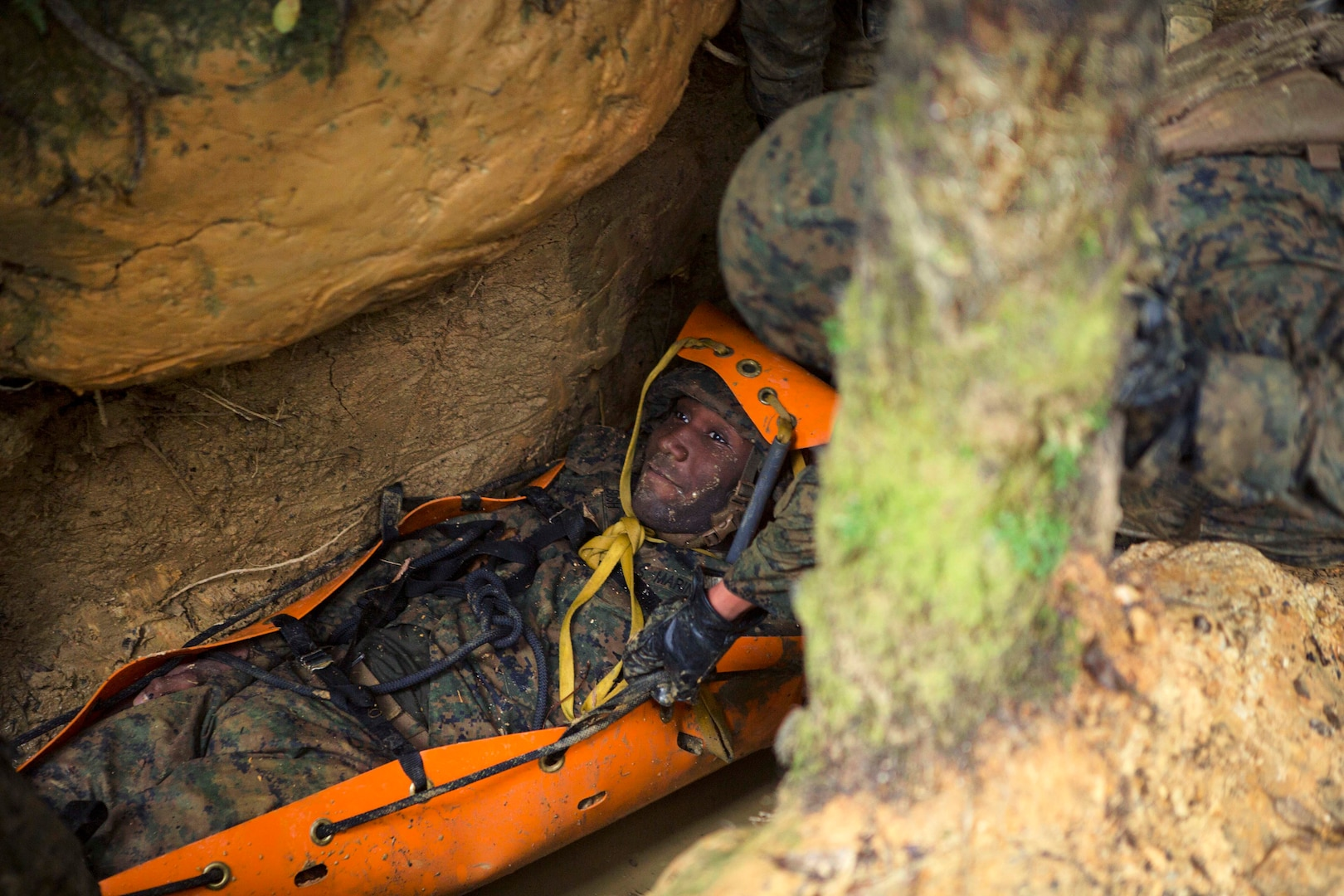 Marine Corps Lance Cpl. Daron Bush role-plays as a simulated casualty during the Endurance Course.