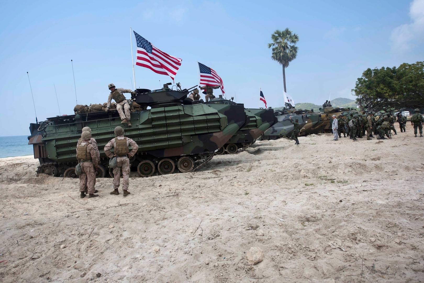 U.S., South Korean and Thai Marines position their assault amphibious vehicles after conducting an amphibious assault.