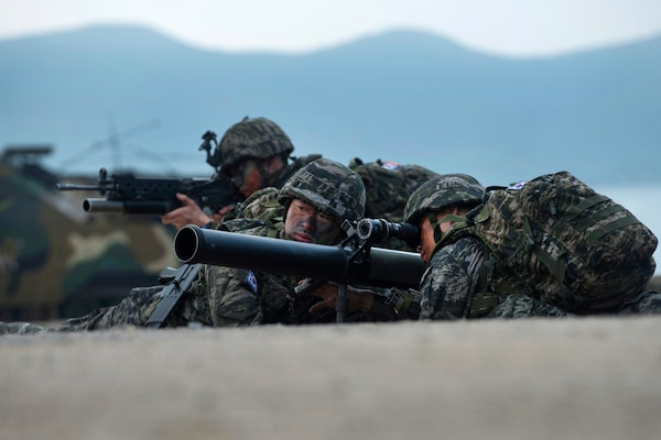 South Korean Marines provide security overwatch during an amphibious assault.