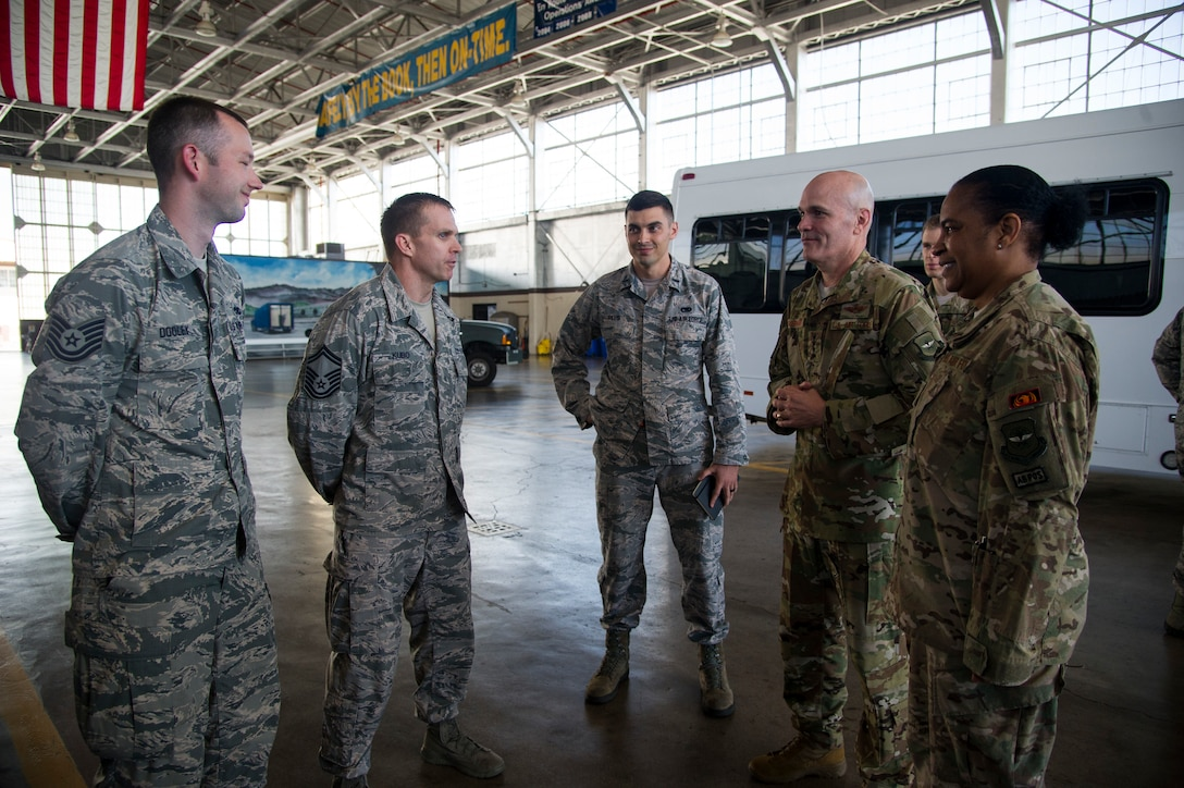Tech. Sgt. Joseph Dooley, Senior Master Sgt. Shawn Kubo, and 1st Lt. Justin Rees, assigned to the 735th Air Mobility Squadron, brief Gen. Carlton D. Everhart, Air Mobility Command commander, and Chief Master Sgt. Shelina Frey, Air Mobility Command command chief, on infrastructure planning in Hanger 9 at Joint Base Pearl Harbor-Hickam, Feb. 11, 2018. Everhart visited the Airmen of the 515th Air Mobility Operations Wing Feb. 6-12 to better understand how the command can support enroute mobility operations and enable global reach for the joint warfighter. The 515th AMOW, headquartered at Joint Base Pearl Harbor-Hickam, Hawaii, oversees Air Mobility Commands enroute maintenance, command and control and aerial port support operations at 26 locations across 100 million square miles in the Pacific. (U.S. Air Force photo by Tech. Sgt. Heather Redman)