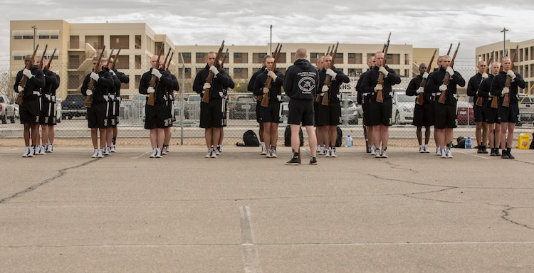"""U.S. Marines with the Marine Corps Silent Drill Platoon conduct practice at Marine Corps Air Station Yuma, Ariz., Feb. 13, 2018 to prepare for their West Coast tour. The Marine Corps Silent Drill Platoon is apart of The Battle Color Detachment along with """"The Commandants Own"""" U.S. Marine Corps Drum & Bugle Corps and The Official Color Guard of the Marine Corps. (U.S. Marine Corps photo by Lance Cpl. Sabrina Candiaflores)"""