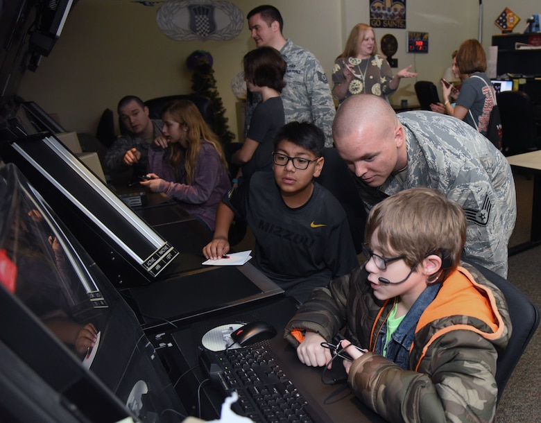 Staff Sgt. Travis Patterson, 334th Training Squadron instructor, briefs Biloxi school students on air traffic control radar simulator capabilities during Biloxi Career Exploration Day at Cody Hall Feb. 14, 2018, on Keesler Air Force Base, Mississippi. The school-aged children also toured the Trainer Development Center, 335th TRS and the Keesler Fire Department. (U.S. Air Force photo by Kemberly Groue)