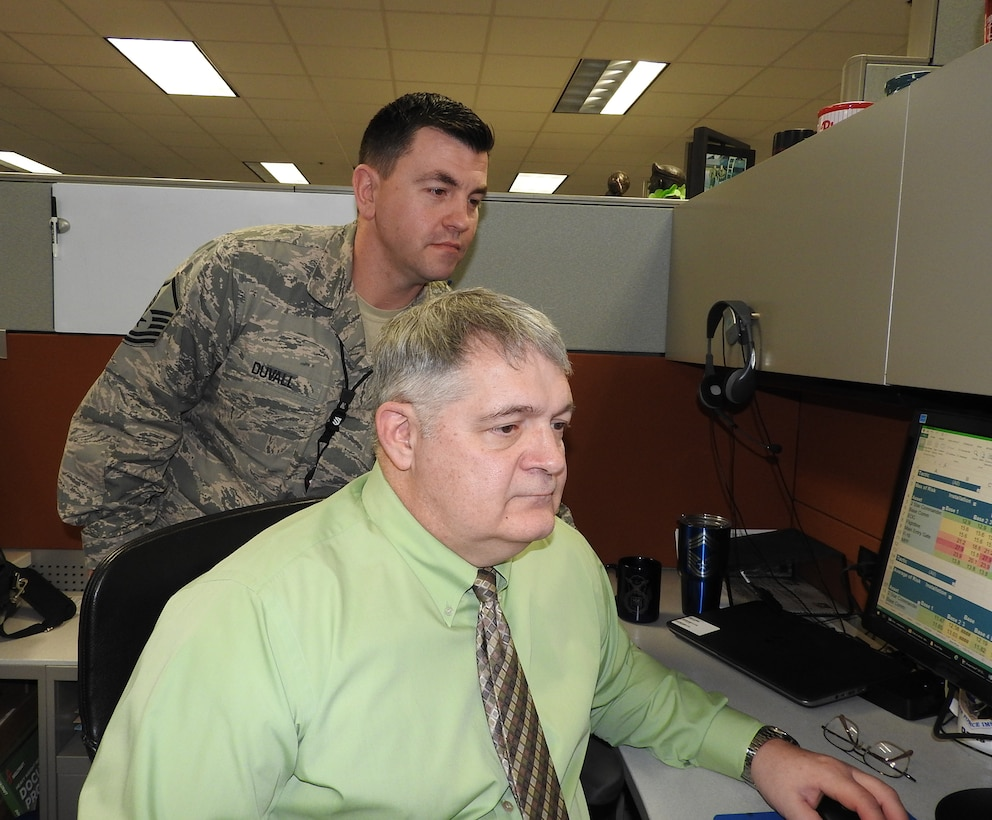 Mark Davis and MSgt Richard Duvall from the AFIMSC Installation Support Directorate Integrated Defense Integration Cell, look at data gathered for analysis.  He has been selected as the 2017 Air Force Outstanding Security Forces Higher Headquarters Civilian of the Year.  Davis is part of a think-tank initiative that takes problems and analyzes data to provide courses of action in innovative ways.