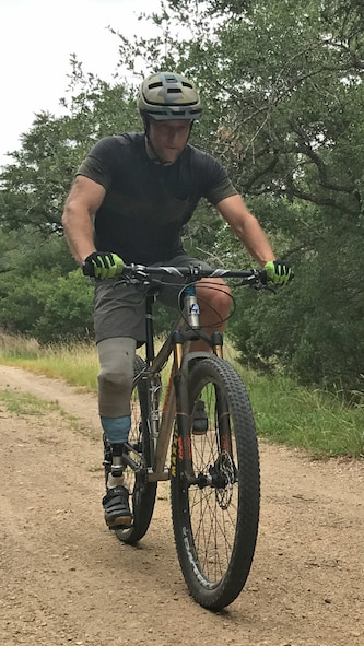 Chief Master Sgt. Chad Caden, the chief enlisted manager with the 633rd Civil Engineer Squadron at Joint Base Langley-Eustis, takes his first mountain bike ride with his prosthetic leg in Austin, Texas. (Courtesy photo)