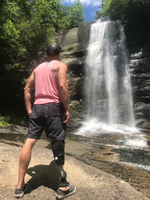 Chief Master Sgt. Chad Caden, the chief enlisted manager with the 633rd Civil Engineer Squadron at Joint Base Langley-Eustis, was able to go hiking in South Carolina in July 2017, nearly 7 months after receiving an amputation on his right leg. After years of pain, Caden was diagnosed with Osteonecrosis in his right foot, which caused a loss of blood flow to his foot and resulting in bone decay. Caden received his amputation on Dec. 27, 2016 to get rid of the pain, minimize the chance of the bone disease spreading, and increase his chance of returning to an active lifestyle. (Courtesy photo)