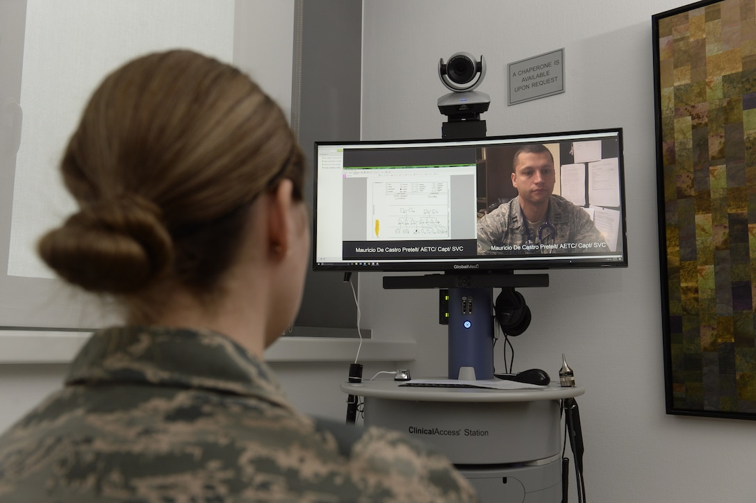 Senior Airman Kimberly Deveau (left) at Spangdahlem Air Base, Germany consults with geneticist, Capt. (Dr.) Mauricio De Castro, staff medical geneticist at Keesler Air Force Base, Miss., using the Clinical Access Station, Feb. 1, 2018. The tele-genetics pilot program connects patients directly to specialized genetic counselors and geneticists from other locations. (U.S. Air Force photo by Staff Sgt. Jonathan Snyder)