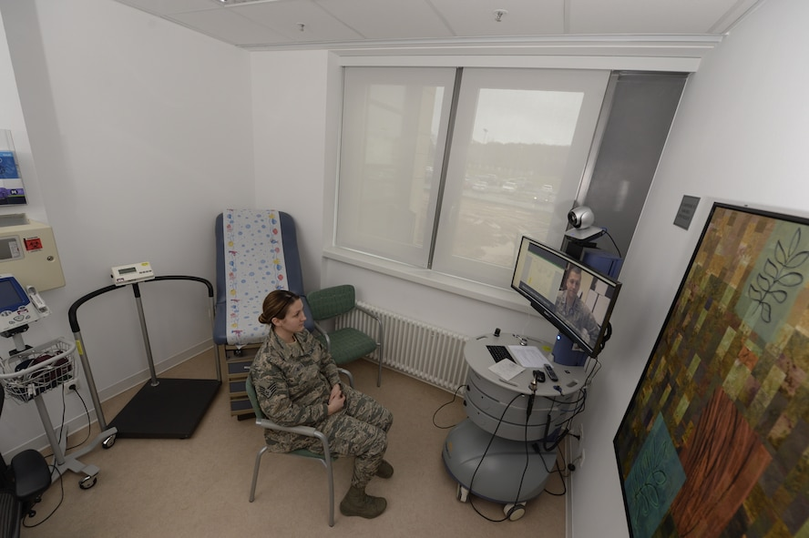 Senior Airman Kimberly Deveau sits in a private room at Spangdahlem Air Base, Germany as she receives specialty genetic counseling via a video teleconference from Capt. (Dr.) Mauricio De Castro, staff medical geneticist at Keesler Air Force Base, Miss., Feb. 1, 2018. The tele-genetics pilot program connects patients directly to specialized genetic counselors and geneticists from other locations. (U.S. Air Force photo by Staff Sgt. Jonathan Snyder)