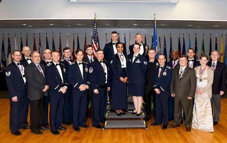 Fourteenth Flying Training Wing annual award winners stand with Col. Douglas Gosney, 14th FTW commander, and Chief Master Sgt. Johnathan Hover, 14th FTW command chief, during the 2017 Annual Awards Banquet, Feb. 9, 2017, on Columbus Air Force Base, Mississippi. Fifty-five members and two flights, which represented 20 categories, were recognized during the evening and competed for 20 wing level awards. Awards show. (U.S. Air Force photo by Melissa Doublin)