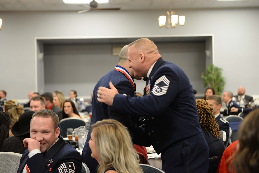 Master Sgt. Joshua Matias, 14th Operations Group control tower chief controller shakes the hand of 14th Operations Group Superintendent, Chief Master Sgt. Bradley Reilly Feb. 9, 2018, on Columbus Air Force Base, Mississippi after winning the Senior Non Commissioned Officer of the Year. Nominees were introduced at the beginning of the event, highlighting everyone's accomplishments before the winners were announced. (U.S. Air Force photo by Airman 1st Class Keith Holcomb)