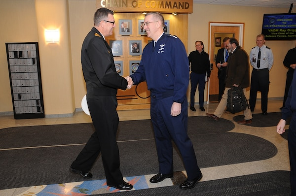 U.S. Air Force Gen. John Hyten, commander of U.S. Strategic Command (USSTRATCOM), greets Australian Navy Vice Adm. Raymond Griggs, Vice Chief of the Defence Force, upon Griggs' arrival at USSTRATCOM headquarters, Offutt Air Force Base, Neb., Feb. 21, 2018. During his visit, Griggs participated in bilateral discussions with Hyten and other USSTRATCOM leaders and subject matter experts on a variety of topics of mutual interest for Australia and the United States. Engagements like this are part of the long-standing partnership between the two allies to promote regional and global stability. One of nine Department of Defense unified combatant commands, USSTRATCOM has global responsibilities assigned through the Unified Command Plan that include strategic deterrence, nuclear operations, space operations, joint electromagnetic spectrum operations, global strike, missile defense, and analysis and targeting.