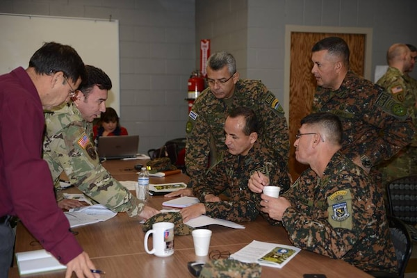 Soldiers from the Salvadoran Army participate in a break out session with representatives from U.S. Army South during day two of staff talks steering committee meetings Feb. 14.