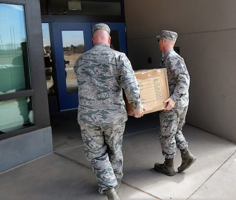 """""""Fighting Tigers"""" Chiefs Donate Books to Kids"""