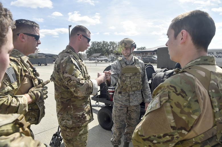 Tech. Sgt. Nicholas T. Piper, left, 628th Logistics Readiness Squadron Forward Area Refueling Point team chief offers encouragement to Airman 1st Class Nathan Lynch, 628th Logistics Readiness Squadron fuels distribution operator, prior to Lynch participating in a Forward Area Refueling Point team tryout Feb. 15, 2018.