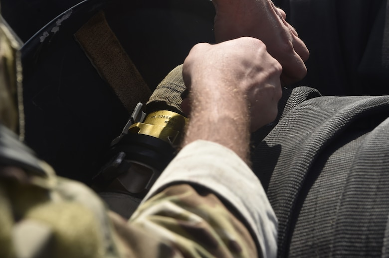 Tech. Sgt. Nicholas T. Piper, 628th Logistics Readiness Squadron Forward Area Refueling Point team chief, straps in a fuel hose prior to the start of a FARP team tryout here Feb. 15, 2018.
