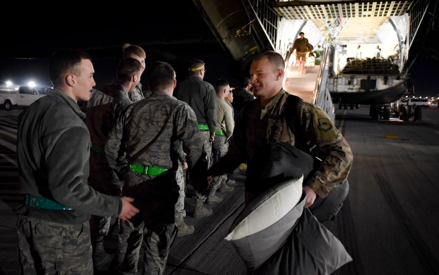 An 823rd Maintenance Squadron Airman is greeted by his peers after returning from a deployment Feb. 8, 2018, at Nellis Air Force Base, Nevada. The Airmen also deployed with Guardian Angel teams from the 306th Rescue Squadron at Davis-Monthan Air Force Base, Arizona. (U.S. Air Force photo by Airman 1st Class Andrew D. Sarver)