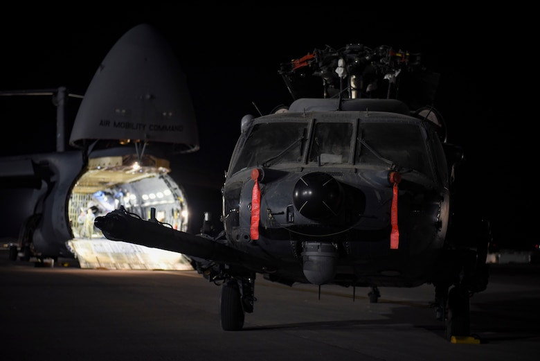 An HH-60G Pave Hawk Helicopter sits on the runway after being unloaded from a C-5M Super Galaxy Feb. 8, 2018, at Nellis Air Force Base, Nevada. The Pave Hawk is a highly modified version of the Army Black Hawk helicopter and serves as the Air Force's premier combat search and rescue aircraft. (U.S. Air Force photo by Airman 1st Class Andrew D. Sarver)