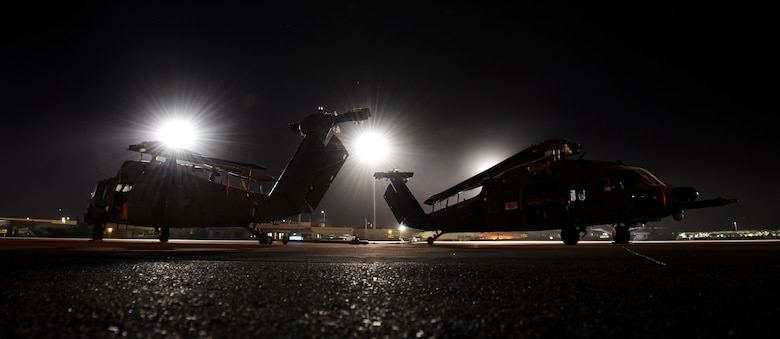 HH-60G Pave Hawk helicopters sit on the runway after being unloaded from a C-5M Super Galaxy Feb. 8, 2018, at Nellis Air Force Base, Nevada. The Pave Hawk is a highly modified version of the Army Black Hawk helicopter. (U.S. Air Force photo by Airman 1st Class Andrew D. Sarver)