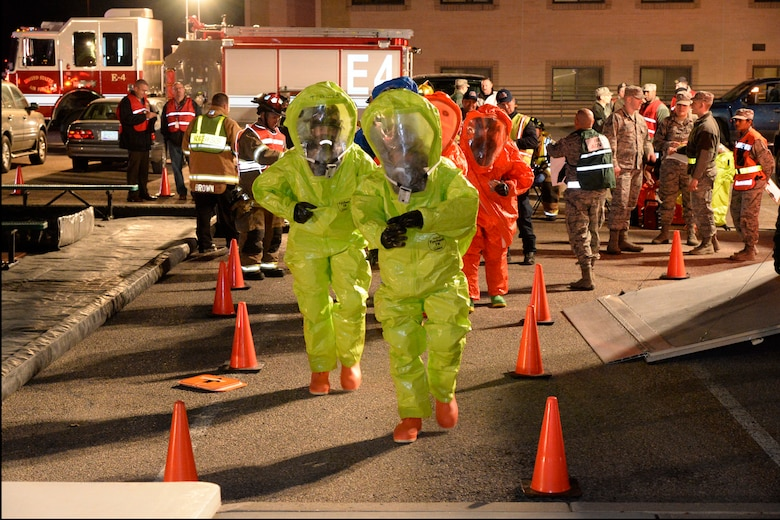 Firefighter and bioenvironmental teams suit up to enter the scene during an emergency response exercise Jan. 30, 2018, at Hill Air Force Base, Utah. (U.S. Air Force photo by Todd Cromar)