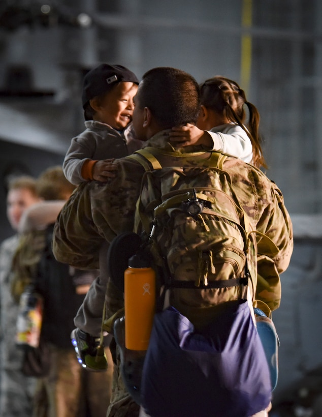 An member of the 823rd Maintenance Squadron is greeted by his family after returning from a deployment Feb. 8, 2018, at Nellis Air Force Base, Nevada. Airmen spent 4 months deployed to Southwest Asia to support Operation Inherent Resolve. (U.S. Air Force photo by Airman 1st Class Andrew D. Sarver)