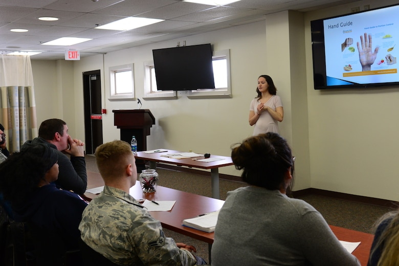 Gabriella Darrow, 341st Medical Operations Squadron health promotion dietician, coaches individuals on health and nutrition Feb. 5, 2018, at Malmstrom Air Force Base, Mont.