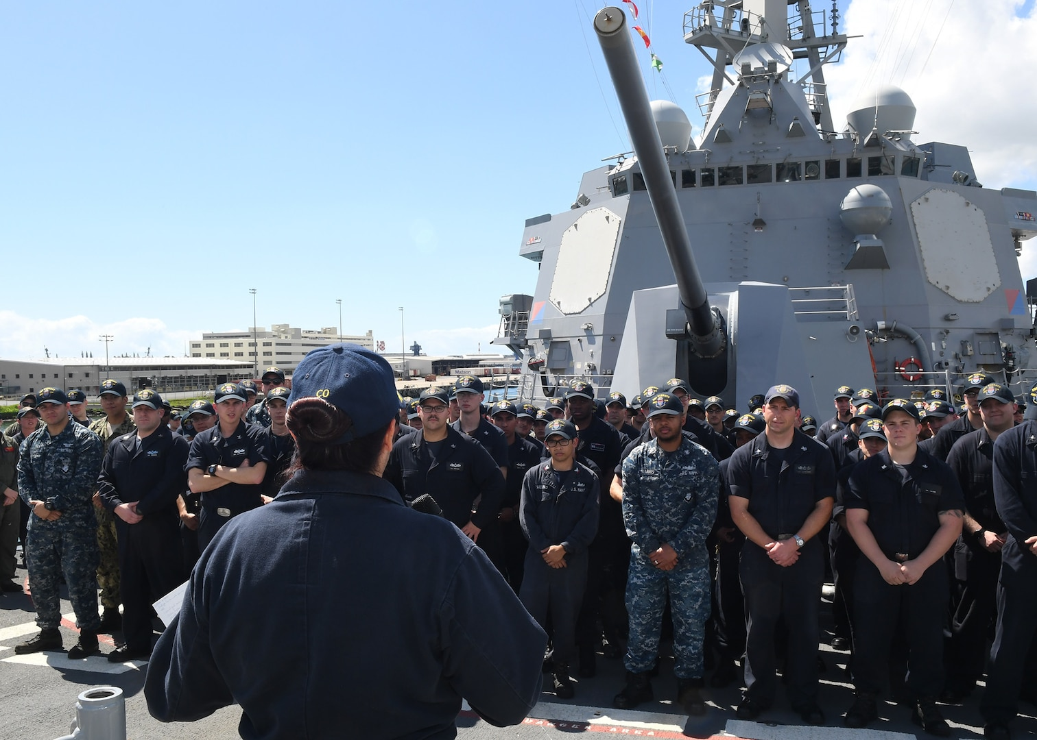 Arleigh Burke-class guided-missile destroyer USS Sterett (DDG 104) Commanding Officer Cmdr. Claudine Caluori addresses the crew during an all-hands call. Sterett is on a scheduled deployment to conduct operations in the Indo-Pacific region. It will also support the Wasp Expeditionary Strike Group (ESG) in order to advance U.S. Pacific Fleet's Up-Gunned ESG concept and will train with forward-deployed amphibious ships across all mission areas.