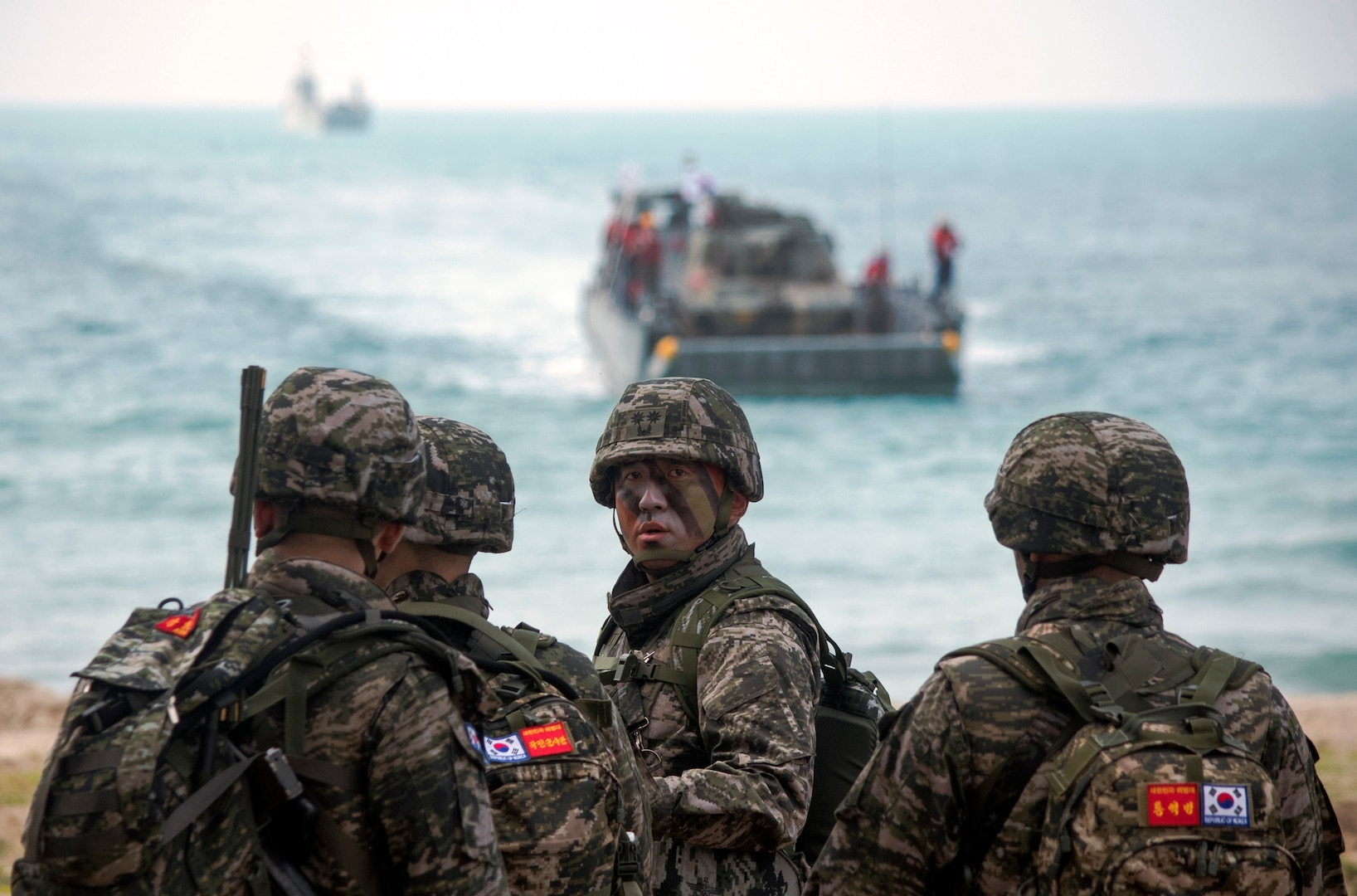 Republic of Korea Marines await the arrival of a ROK landing craft utility on Hat Yao Beach, Rayong province, Thailand during Exercise Cobra Gold 2018, Feb. 17, 2018. CG18 provides a venue for the United States, allied and partner nations to advance interoperability and increase partner capacity in planning and executing complex and realistic multinational force and combined task force operations. CG18 is an annual exercise conducted in the Kingdom of Thailand held from Feb. 13-23 with seven full participating nations.
