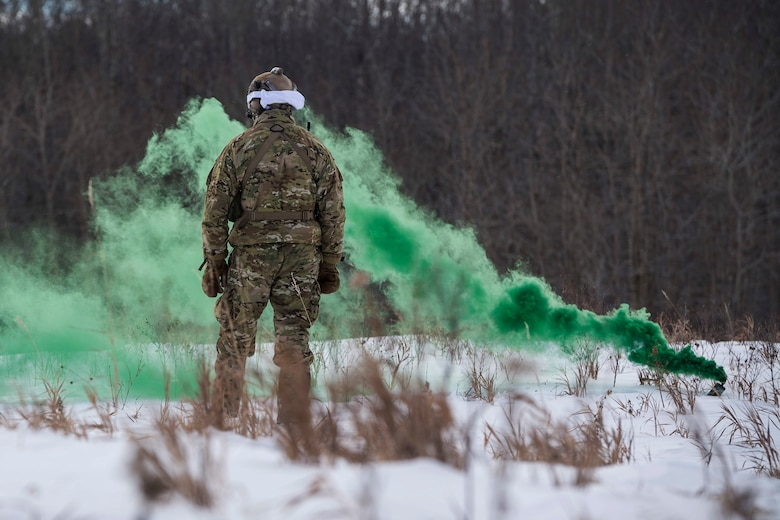 Defenders from the 91st Security Forces Group, Minot Air Force Base, North Dakota, participated in a three-day field training exercise in the Turtle Mountain State Forest, North Dakota, Feb. 12-14, 2018. During the training, 91st SFG Airmen learned survival techniques including; how to build shelters and fires, set snares, navigate to a landing zone and vector rescue helicopters. (U.S. Air Force photo by Senior Airman J.T. Armstrong)