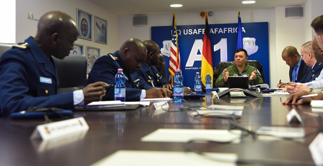 U.S. Air Force Col. Ric Trimillos, U.S. Air Forces in Europe and Africa International Affairs Division chief, speaks to representatives with the Senegal Air Force about aircraft maintenance at USAFE Headquarters, on Ramstein Air Base, Germany, Feb. 16, 2018. The representatives visited USAFE - HQ was to facilitate discussions on force development, force sustainment, retention, growth management, aircraft maintenance, and logistics.