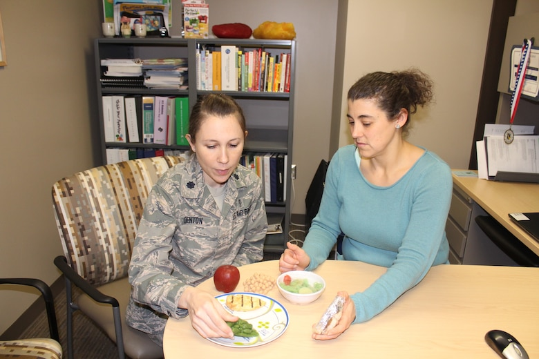 Lt. Col. Amanda Denton, Nutritional Medicine Flight commander and AFMC nutrition consultant, and Kendra Schmuck nutrition clinic manager, can help patients achieve their personal nutrition goals for a healthier lifestyle. The 88th Medical Group nutrition clinic provides medical nutritional therapy for active duty members, retirees and their dependents offering classes and individual appointments to provide nutritional guidance. (U.S. Air Force Photo/Stacey Geiger)