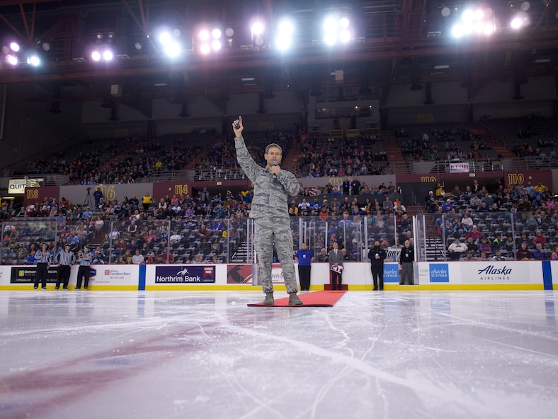 Air Force Lt. Gen. Kenneth Wilsbach, Alaskan Command commander, greets the crowd before ceremonially dropping the puck, Nov. 12, 2016, at the Sullivan Arena in Anchorage, Alaska. The Alaska Aces ECHL hockey team hosted the Indianapolis Fuel during military appreciation games Nov. 9, 11 and 12 at the Sullivan Arena. (U.S. Army National Guard photo by Sgt. David Bedard)