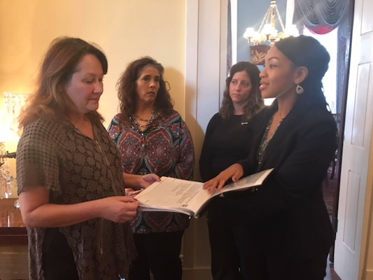Volunteers from the Key Spouse Program, a program that assists Air Force families within the Joint Base San Antonio community, went to Austin, Texas this past January and met with Texas First Lady Cecilia Abbott (left) as they highlighted the program's success.
