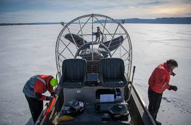 Lake Pepin ice survey team members measure the ice