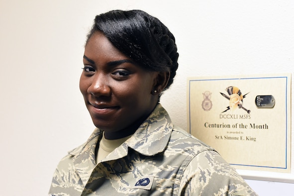 Senior Airman Simone King, 341st Security Forces Support Squadron commander support staff, poses in her office Feb. 21, 2018, at Malmstrom Air Force Base, Mont. King brings her voice and perspective to the Malmstrom community discussing Black History Month. (U.S. Air Force photo by Kiersten McCutchan)