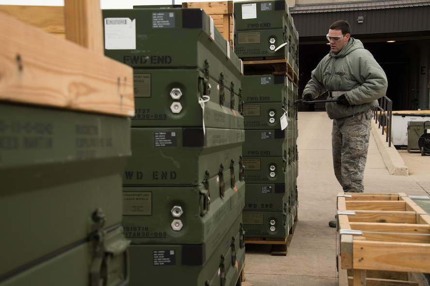 Airmen 1st Class Justin Stoeckle, 649th Munitions Squadron, removes banding from munition pallets during a readiness exercise Jan. 30, 2018, at Hill Air Force Base, Utah. (U.S. Air Force photo by R. Nial Bradshaw)