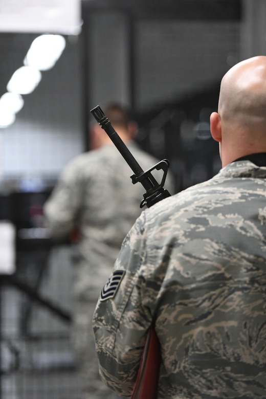 An Airman waits to return his weapon during a weapon issue simulation and readiness exercise Jan. 29, 2018, at Hill Air Force Base, Utah. Airmen simulated the process of filling their mobility bags, weapon issue, and going through a pre-deployment function line. (U.S. Air Force photo by Cynthia Griggs)