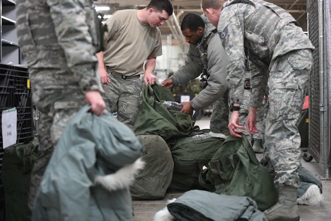 Airmen fill their mobility bags during a readiness exercise Jan. 29, 2018, at Hill Air Force Base, Utah. Airmen simulated the process of filling their mobility bags, weapon issue, and going through a pre-deployment function line. (U.S. Air Force photo by Cynthia Griggs)