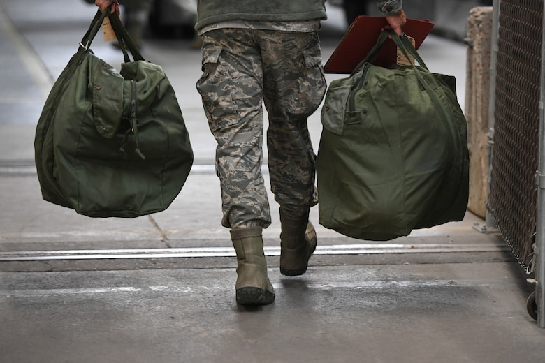 Airmen load mobility bags during a readiness exercise Jan. 29, 2018, at Hill Air Force Base, Utah. Airmen simulated the process of filling their mobility bags, weapon issue, and going through a pre-deployment function line. (U.S. Air Force photo by Cynthia Griggs)
