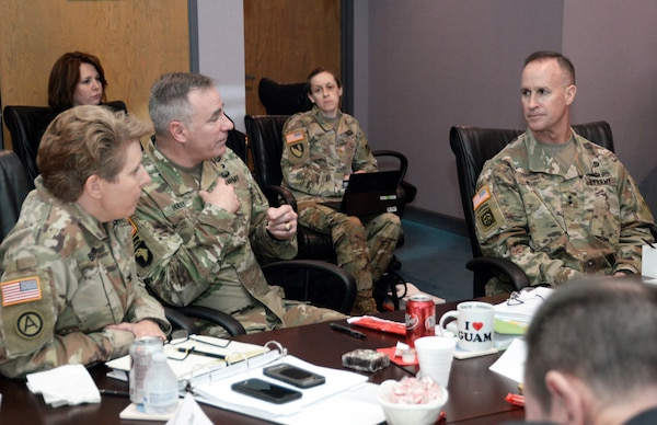 Maj. Gen. Michael Wehr, deputy commanding general U.S. Army Corps of Engineers, right, and Col. Christine Beeler, left, listen as Col. John Hurley, U.S. Army Engineering and Support Center, Huntsville commander discusses actions presented during the Center's command strategic review Feb. 13-14.