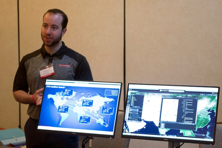 A technology company representative demonstrates network management solutions during the 2018 Luke Tech Expo at Luke Air Force Base, Ariz., Feb. 22, 2018. The tech expo invited all interested Luke Airmen to get a glimpse at new advances and future technology solutions. (U.S. Air Force photo/Senior Airman Ridge Shan)