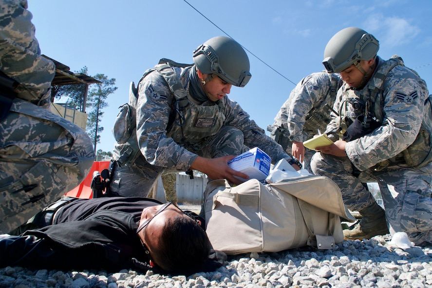 Airman First Class David Lovell Pieper Victorino, 154th Security Forces Squadron fire team member, provides simulated medical care to an injured civilian during Patriot South exercise, Feb. 13, 2018, at Camp Shelby, Mississippi.