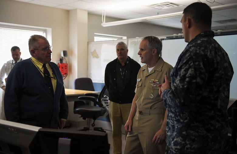 NEWPORT, R.I. (Feb. 21, 2018) Vice Adm. Phil Sawyer, commander, U.S. 7th Fleet, talks with Bud Weeks (left), director, Surface Warfare Officers School's (SWOS) Navigation, Seamanship and Shiphandling and Capt. Scott Robertson (right), SWOS' commanding officer during a visit to the school. Sawyer's purpose was to provide an overview of 7th Fleet readiness and to provide feedback on how training ties into ensuring safe and effective operations at sea.