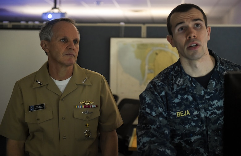 NEWPORT, R.I. (Feb. 21, 2018) Vice Adm. Phil Sawyer, commander, U.S. 7th Fleet, watches as Lt. James Beja, an instructor at Surface Warfare Officers School (SWOS), provides an overview of one of the training programs. Sawyer's purpose was to provide an overview of 7th Fleet readiness and to provide feedback on how training ties into ensuring safe and effective operations at sea.